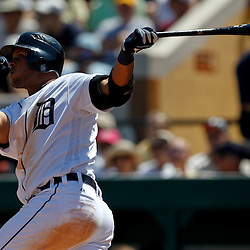 March 26, 2012; Lakeland, FL, USA; Detroit Tigers shortstop Jhonny Peralta (27) hits a homerun during the bottom of the fourth inning of a spring training game against the Miami Marlins at Joker Marchant Stadium. Mandatory Credit: Derick E. Hingle-US PRESSWIRE