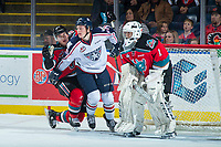 KELOWNA, CANADA - OCTOBER 27: Kyle Olson #25 of the Tri-City Americans checks Cal Foote #25 in front of the net of James Porter #1 of the Kelowna Rockets on October 27, 2017 at Prospera Place in Kelowna, British Columbia, Canada.  (Photo by Marissa Baecker/Shoot the Breeze)  *** Local Caption ***