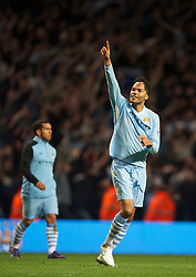 MANCHESTER, ENGLAND - Monday, April 30, 2012: Manchester City's Joleon Lescott celebrates his side's 1-0 victory over rivals Manchester United during the Premiership match at the City of Manchester Stadium. (Pic by David Rawcliffe/Propaganda)