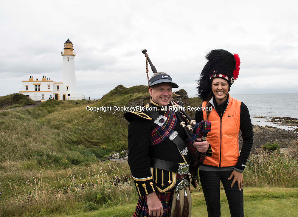 Picture by Christian Cooksey/CookseyPix.com.<br /> Ricoh Women's British Open.Golf superstar Michelle Wie (right) try's on Piper Bryce McCulloch's bonnet during a photo call at the lighthouse. The world's best female golfers are heading to Trump Turnberry in Ayrshire this week for the Ricoh Women's British Open which starts on Thursday. Repro fee payable. Credit CookseyPix.com