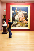 Man looking at Ingres painting in permanent collection of Granet Museum in Aix-en-Provnce, France.