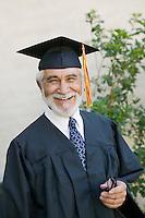 Senior graduate smiling outside portrait