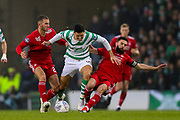 Tomas Rogic (#18) of Celtic battles to maintain possession of the ball under pressure from Dominic Ball (#21) of Aberdeen and Graeme?Shinnie (#3) of Aberdeen during the Betfred Cup Final between Celtic and Aberdeen at Celtic Park, Glasgow, Scotland on 2 December 2018.