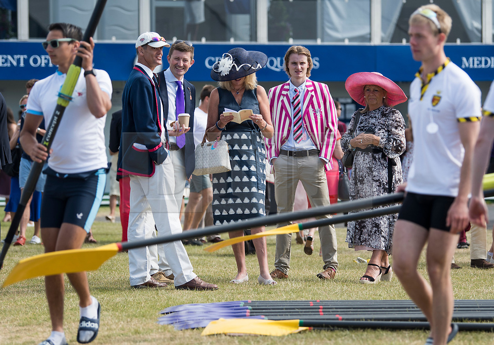 © Licensed to London News Pictures. 04/07/2018. Henley-on-Thames, UK. Rowing club members watch day one of the Henley Royal Regatta, set on the River Thames by the town of Henley-on-Thames in England. Established in 1839, the five day international rowing event, raced over a course of 2,112 meters (1 mile 550 yards), is considered an important part of the English social season. Photo credit: Ben Cawthra/LNP