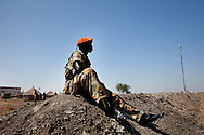 An SPLA solider peers across the border between the north and the south in Upper Nile state.