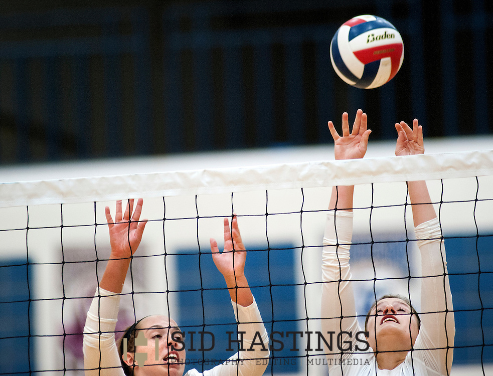 25 AUG. 2015 -- ST. CHARLES, Mo. --Duchesne High School volleyball players Corinne Stulce (3) and Katie Schmidt (12) leap to block a shot  against St. Pius X High School at Duchesne in St. Charles, Mo. Tuesday, Aug. 25, 2015. St. Pius won, 2-0 (25-14, 25-23), to advance to 6-0. It was Duchesne's first match, dropping them to 0-1 on the year. Photo © copyright Sid Hastings.