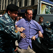 Gay activist Peter Tatchell is arrested by Russian police after he had been punched in the eye by an anti-gay and sprayed with water by Orthodox Christians. .Authorities, nationalist protesters and Orthodox Christians forcefully prevented gay and lesbian rights activists from rallying in Moscow..Homosexuality was decriminalized in Russia in 1993. Moscow has repeatedly banned gay parades, including this one. .
