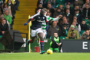 Dundee's Kevin Gomis strides away rom Celtic's Ryan Christie - Celtic v Dundee in the Ladbrokes Scottish Premiership at Celtic Park, Glasgow. Photo: David Young<br /> <br />  - © David Young - www.davidyoungphoto.co.uk - email: davidyoungphoto@gmail.com
