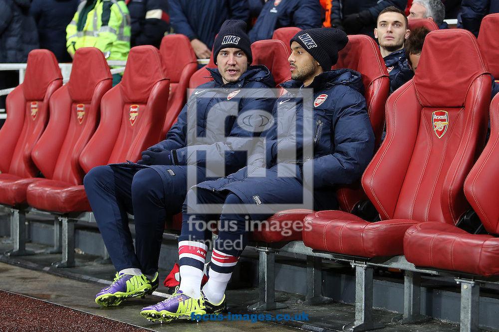 Picture by Richard Calver/Focus Images Ltd +447792 981244<br /> 26/11/2013<br /> Nicklas Bendtner and Theo Walcott of Arsenal on the substitutes bench before the UEFA Champions League match against Olympique de Marseille at the Emirates Stadium, London.