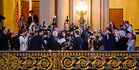 Media crowd around a judge Alfrado Pedroza, as he marries Paul Hill and Brad Akin inside the San Francisco City Hall, on the second day of legal gay marriages in California.