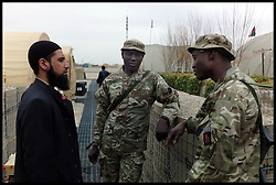 MOD Imam Asim Hafiz meeting British Muslim Soldiers before taking Friday Prays in Mosque at Camp Bastion in Afghanistan , Friday 24 January 2014, Picture by Andrew Parsons / Parsons Media Ltd