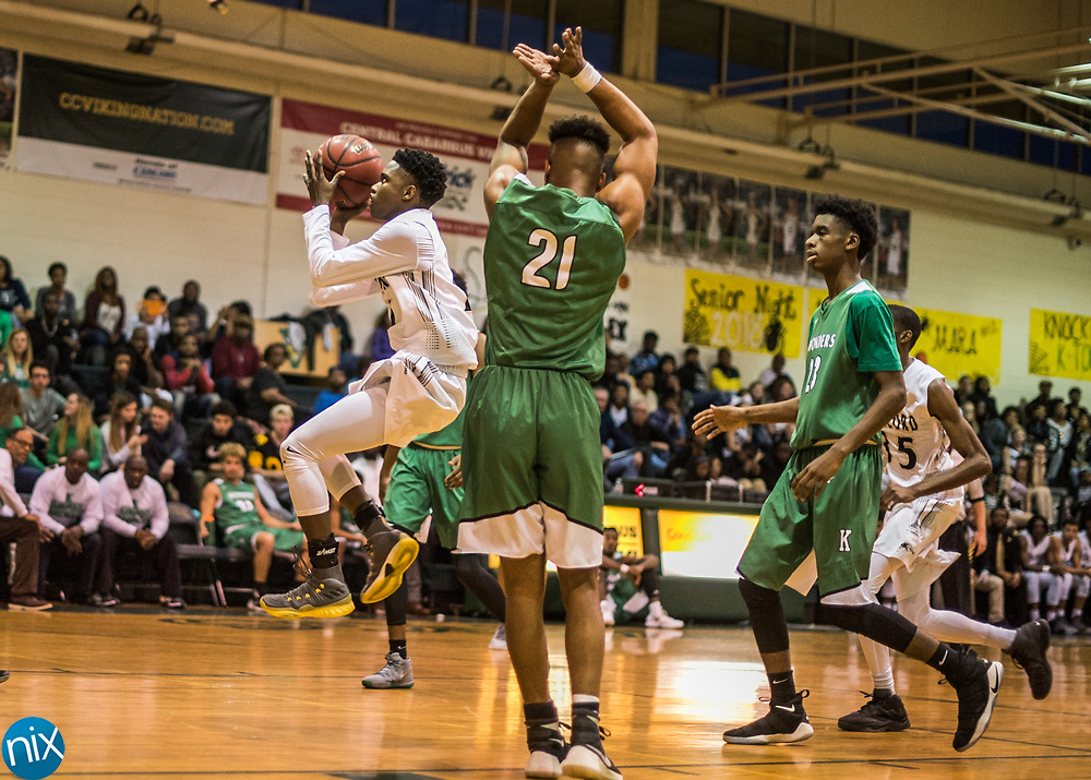 Concord's Dajon Johnson (1) goes up for a shot against A.L. Brown during a South Piedmont Conference basketball game Saturday night at Central Cabarrus High School.
