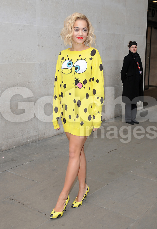 Singer Rita Ora wearing a SpongeBob SquarePants dress visits Radio 1 and releases balloons in Leicester Square to mark her new single 'I Will Never Let You Down'. London, UK. 31/03/2014<br />BYLINE MUST READ : GOTCHAIMAGES.COM<br /><br />Copyright by &copy; Gotcha Images Ltd. All rights reserved.<br />Usage of this image is conditional upon the acceptance <br />of Gotcha Images Ltd, terms and conditions available at<br />www.gotchaimages.com