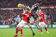 Middlesbrough midfielder Lewis Wing (26) under pressure from Millwall defender Murray Wallace (25) and Millwall defender Ben Marshall (44) during the EFL Sky Bet Championship match between Middlesbrough and Millwall at the Riverside Stadium, Middlesbrough, England on 19 January 2019.