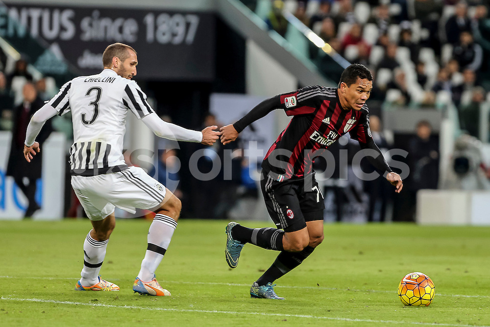 Carlos Bacca of AC Milan runs with the ball with Giorgio Chiellini of Juventus during the Serie A TIM match between Juventus and AC Milan at the Juventus Stadium, Turin, Italy on 21 November 2015. Photo by sync studio.