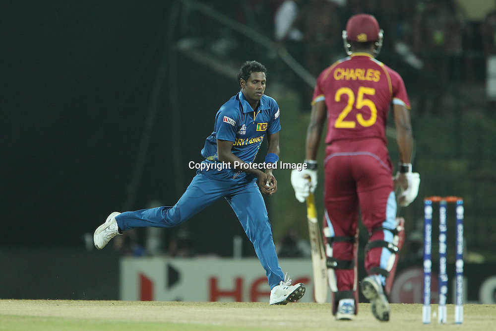 Angelo Matthews fields from his own bowling during the ICC World Twenty20 Super 8s match between Sri Lanka and The West Indies held at the  Pallekele Stadium in Kandy, Sri Lanka on the 29th September 2012<br /> <br /> Photo by Ron Gaunt/SPORTZPICS