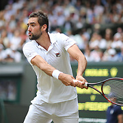 LONDON, ENGLAND - JULY 16: Marin Cilic of Croatia in action against Roger Federer of Switzerland in the Gentlemen's Singles final of the Wimbledon Lawn Tennis Championships at the All England Lawn Tennis and Croquet Club at Wimbledon on July 16, 2017 in London, England. (Photo by Tim Clayton/Corbis via Getty Images)