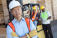 Portrait of a man in front of two workers