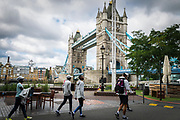 Members of the Refugee Athletes Team walk past London's Tower Bridge on their way to a training session ahead of the World Athletics Championships, which begins tonight.