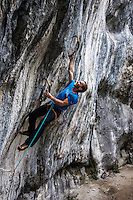 Jeff Mercier, Rab and Petzl athlete, as seen during rapid ascent of M12-graded dry-tooling route in Annecy, France on a cold Autumn afternoon.