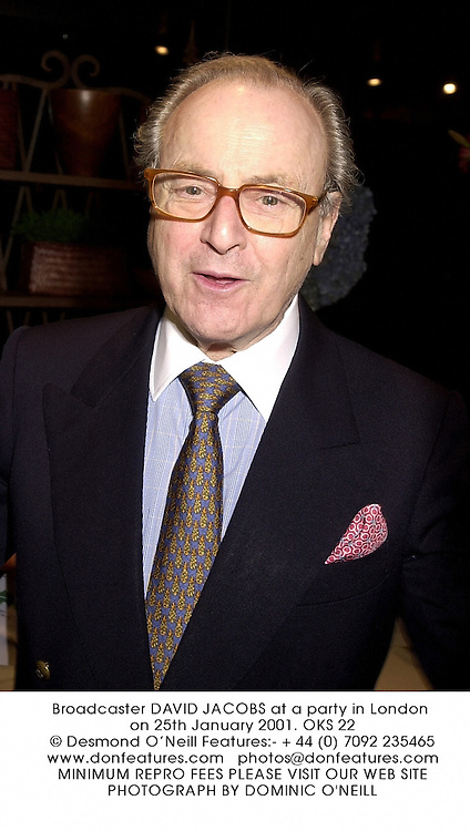 Broadcaster DAVID JACOBS at a party in London on 25th January 2001.	OKS 22