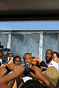 Matt Roth/Novus Select.Thursday, March 22, 2012..Members of the press photograph Rev. Al Sharpton, while he announces that the Sanford Chief of Police Bill Lee has temporarily stepped down before the official start of a rally addressing Trayvon Martin's killing at Fort Mellon Park in Sanford, Florida Thursday, March 22, 2012. Sharpton is flanked by Sybrina Fulton, the mother of Trayvon Martin, directly left of Sharpton, and Tracy Martin, right, the father of Trayvon Martin, and President of the NAACP Benjamin Jealous, far right...Rev. Al Sharpton spoke at the rally for the slain black teen who was unarmed and shot after an altercation by neighborhood watch volunteer George Zimmerman, who pursued Trayvon on foot after being told not to by 911 dispatchers. Zimmerman has yet to be arrested because of Florida's Stand Your Ground Law.