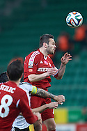 Wisla's Pawel Brozek fights for the ball during T-Mobile ExtraLeague soccer match between Legia Warsaw and Wisla Krakow in Warsaw, Poland.<br /> <br /> Poland, Warsaw, March 15, 2015<br /> <br /> Picture also available in RAW (NEF) or TIFF format on special request.<br /> <br /> For editorial use only. Any commercial or promotional use requires permission.<br /> <br /> Mandatory credit:<br /> Photo by © Adam Nurkiewicz / Mediasport