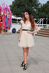 Actress OLIVIA GRANT at the Investec Derby at Epsom Racecourse, Epsom Downs, Surrey on 4th June 2011.