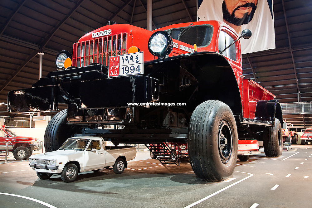 A giant truck dwarfs a normal size pickup at the Emirates Auto Museum, located in the desert outside of Abu Dhabi in the UAE