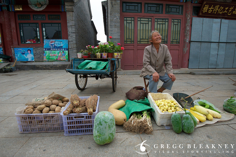 A cycling vegetable vendor in old town -- stage 3's finish host town, Yongning - Stage Three, 162km, Shangyu island to Yongning Town via Thirteen Ming Tombs Reservoir - 2011 Tour of Beijing Scouting Photos