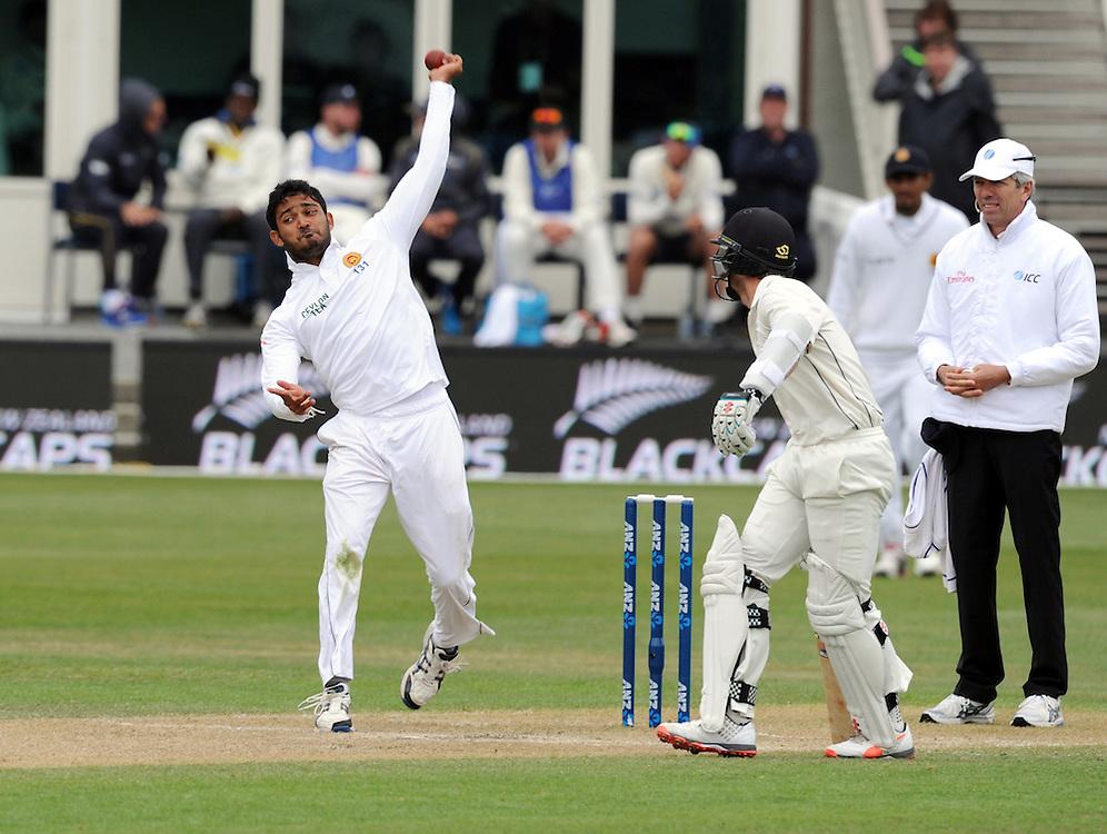 Sri Lanka's Milinda Siriwardana bowls past New Zealand's Kane Williamson on day three of the first International Cricket Test, University Cricket Oval, Dunedin, New Zealand, Saturday, December 12, 2015.Credit:SNPA / Ross Setford