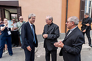 ROME, ITALY - SEPTEMBER 01: Italian PM Paolo Gentiloni greet the director of Caritas Rome, Msgr. Enrico Feroci near New vicar of Rome, Angelo De Donatis, during visit the Citadel of the Charity of the Diocesan Caritas of Rome on September 1, 2017 in Rome, Italy. Italian PM Paolo Gentiloni visited the Caritas to express the gratitude of all Italians to the world of volunteering, to those who work in favour of solidarity.