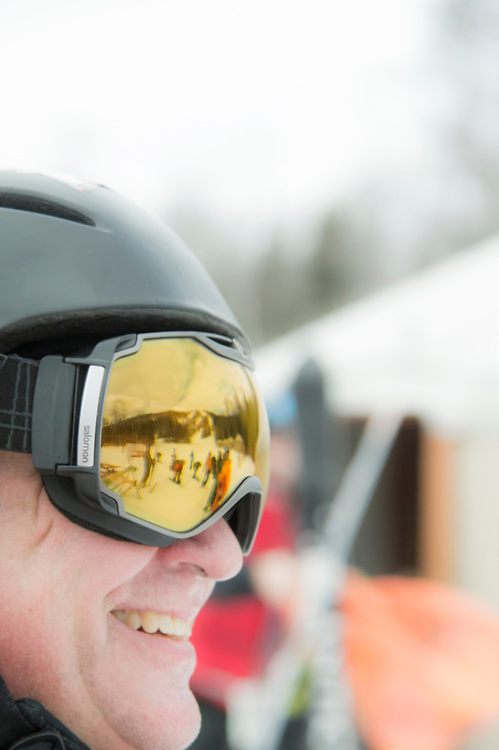 Mount Bohemia ski area reflects in a skiers' goggles.