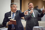 Chaplain Steven Hokana, assistant director of Ministry to the Armed Forces, and Chaplain Craig G. Muehler, director,  laughs with attendees during the Operation Barnabas conference event on Thursday, March 15, 2018, at the Hilton St. Louis Airport hotel in St. Louis. LCMS Communications/Erik M. Lunsford