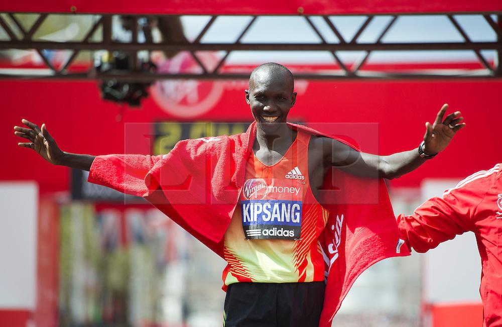 © London News Pictures. 22/04/2012. London, UK. Wilson Kipsang of Kenya celebrates winning the men's elite race during the 2012 Virgin London Marathon on April 22, 2012. Photo credit : Ben Cawthra /LNP