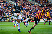 Sam Hoskins of Northampton Town challenged by Zeli Ismail of Bradford City during the EFL Sky Bet League 2 match between Bradford City and Northampton Town at the Utilita Energy Stadium, Bradford, England on 7 September 2019.