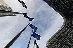 EU flags fly at the European Commission headquarters, in Brussels, Belgium, on Monday, Dec. 19, 2011. (Photo © Jock Fistick).