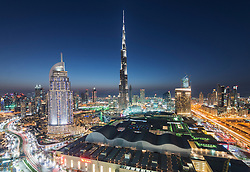 Burj Khalifa and skyline of Downtown Dubai at night in United Arab Emirates