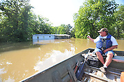 8/13/11} Vicksburg} -- Vicksburg, MS, U.S.A<br />  --Robert Shiers aka Peanut paddles past his hand built cabin in the woods too check on the flood waters Friday May 13,2011 Peanuts flooded cabin on Chickasaw Road was a cabin in the woods is now a cabin on the flooded Mississippi River.  Hope and faith float as the Mississippi River continues to rise around the Kings Community on Friday the 13th of May 2011. &quot;Peanut &quot; aka Robert Shiers navigates his &quot;John Boat&quot; down Chickasaw Rd. in Vicksburg Mississippi. His hand built ,self designed cabin which sits on 14ft. stilts on the old Belle Meade Plantation was on a 5acre wheat field that is now inundated with water and only able to get to by boat.  No mail today for residents of the Kings Community in Vicksburg MS Friday May 13, 2011.The Mississippi River in Vicksburg, Mississippi is expected to crest at a record 58.5 feet. The water is moving at 2.2million cubic feet per second, to put it in perspective it would fill the SuperDome in New Orleans in 30 seconds. Pictured is the historic Yazoo Valley Railroad Station in downtown Vicksburg. The River is flooding over 1.2 million acres of farm land and damaging thousands of homes and disrupting thousands of peoples lives. Vicksburg a riverfront town steeped in war and sacrifice, gets set to battle an age-old companion: the Mississippi River. The city that fell to Ulysses S. Grant and the Union Army after a painful siege in 1863 is marshaling a modern flood-control arsenal to keep the swollen Mississippi from overwhelming its defenses. PHOTO&copy;SUZI ALTMAN.COM<br /> Photo by Suzi Altman