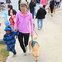 Meredith McCumbee walks with Aaron McCumbee,4, and their dog Hattie before the Paws for People 5K. (Jason A. Frizzelle)