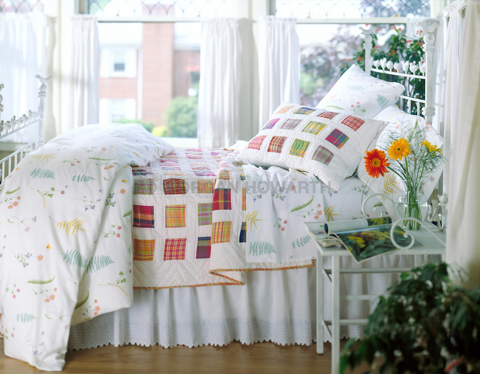 bed with county quilt