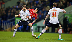 BOLTON, ENGLAND - Wednesday, February 4, 2015: Liverpool's Philippe Coutinho Correia is fouled by Bolton Wanderers' Dorian Dervite during the FA Cup 4th Round Replay match at the Reebok Stadium. (Pic by David Rawcliffe/Propaganda)