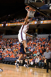 Virginia forward Mike Scott (32) dunks against Richmond.  The Virginia Cavaliers men's basketball team defeated the Richmond Spiders 66-64 in the first round of the College Basketball Invitational (CBI) tournament held at the University of Virginia's John Paul Jones Arena in Charlottesville, VA on March 18, 2008.