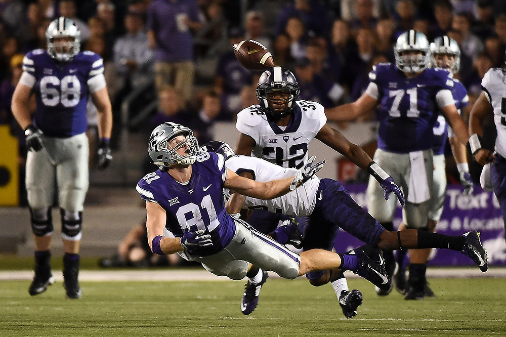 Kansas State's Kyle Klein (81) reaches for a tipped ball while being tackled by TCU's Torrance Mosley (2). <br /> No. 2 TCU Horned Frogs at Kansas State Wildcats at Bill Snyder Family Stadium in Manhattan, Kan. on Saturday, Oct. 10, 2015.<br /> Zach Bland Photo