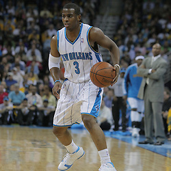 17 December 2008: New Orleans Hornets guard Chris Paul (3) handles the ball during a NBA regular season game between the Western Conference rivals the San Antonio Spurs and the New Orleans Hornets at the New Orleans Arena in New Orleans, LA..