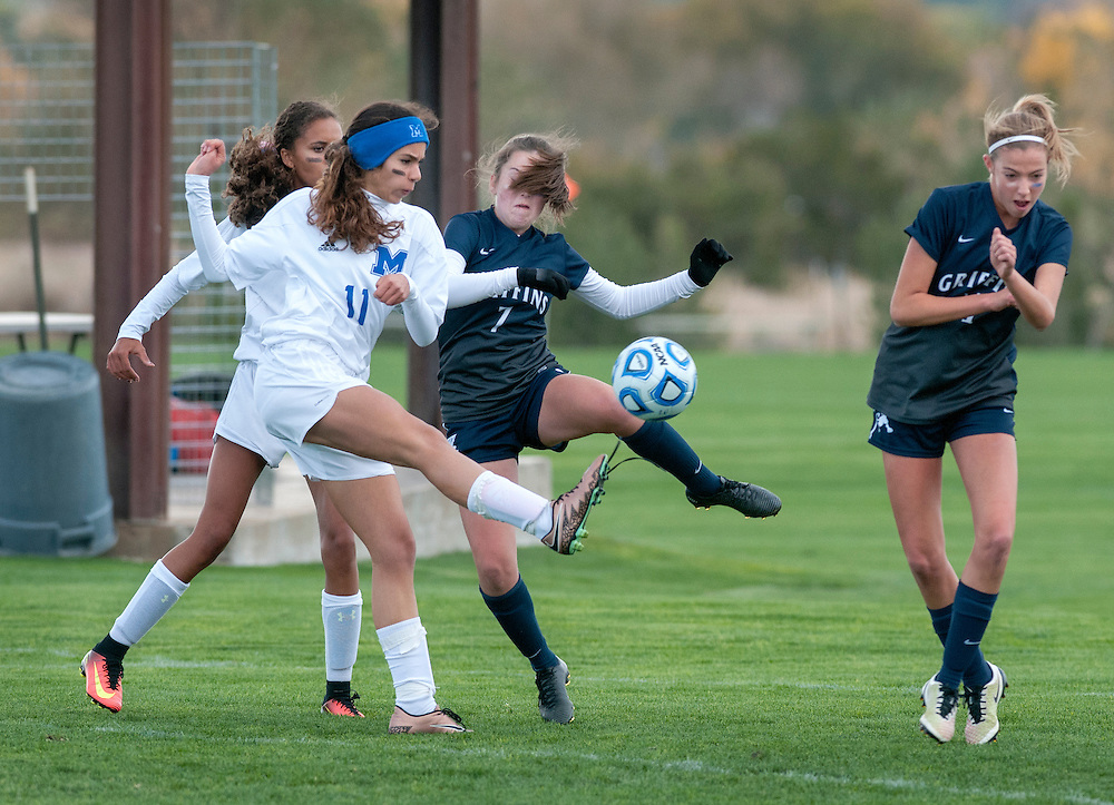 em110316a/jnorth/sports/From left, St. Michael's Astid Giblin fires a shot by Santa Fe Prep's Casey Chandler and Blake Trevisani for the Lady Horsemen's first goal during this state tournament playoff game. The game was played in Bernalillo Thursday November 3, 2016.  (Eddie Moore/Albuquerque Journal