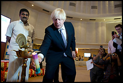 London Mayor Boris Johnson lights a candle the Bombay Stock Exchange, Mumbai, after opening the day's trading, on the final day of his 6 day tour of India, Friday November 30, 2012. Photo by Andrew Parsons / i-Images