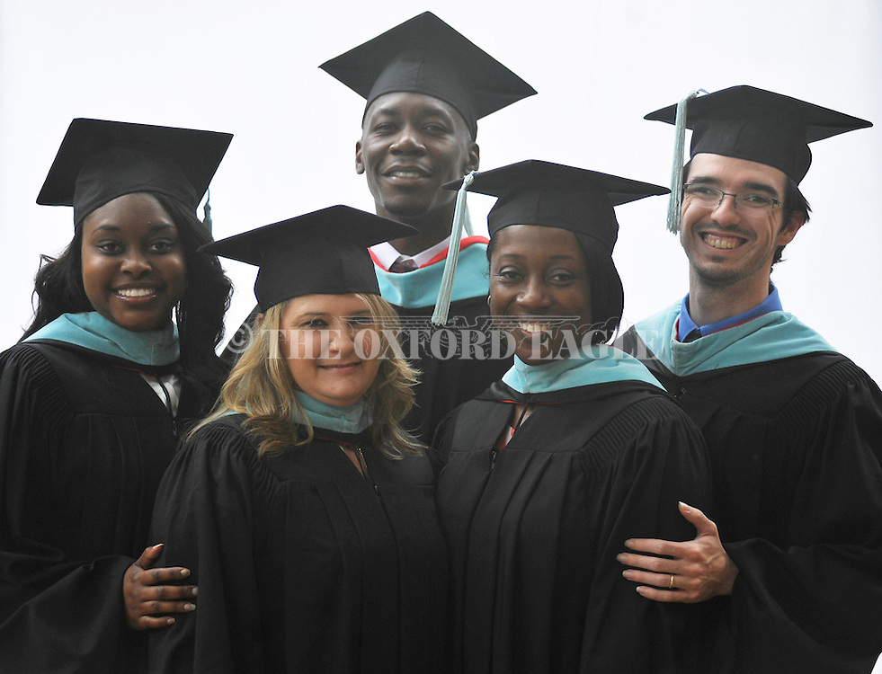 Angela Lowery, Wendi Husley, Marcus Stewart, Trena Warren, and Eric Sumrall at University of Mississippi graduation ceremony in Oxford, Miss. on Saturday, May 9, 2015. (AP Photo/Oxford Eagle, Bruce Newman)