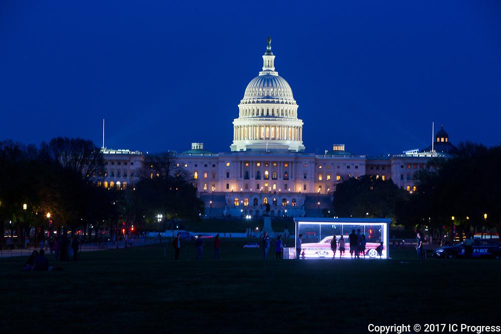 The United States Capital Building in Washington DC illuminated at night.