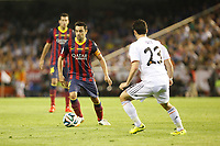 Real Madrid´s Isco (R) and F.C. Barcelona´s Xavi Hernendez during the Spanish Copa del Rey `King´s Cup´ final soccer match between Real Madrid and F.C. Barcelona at Mestalla stadium, in Valencia, Spain. April 16, 2014. (ALTERPHOTOS/Victor Blanco)